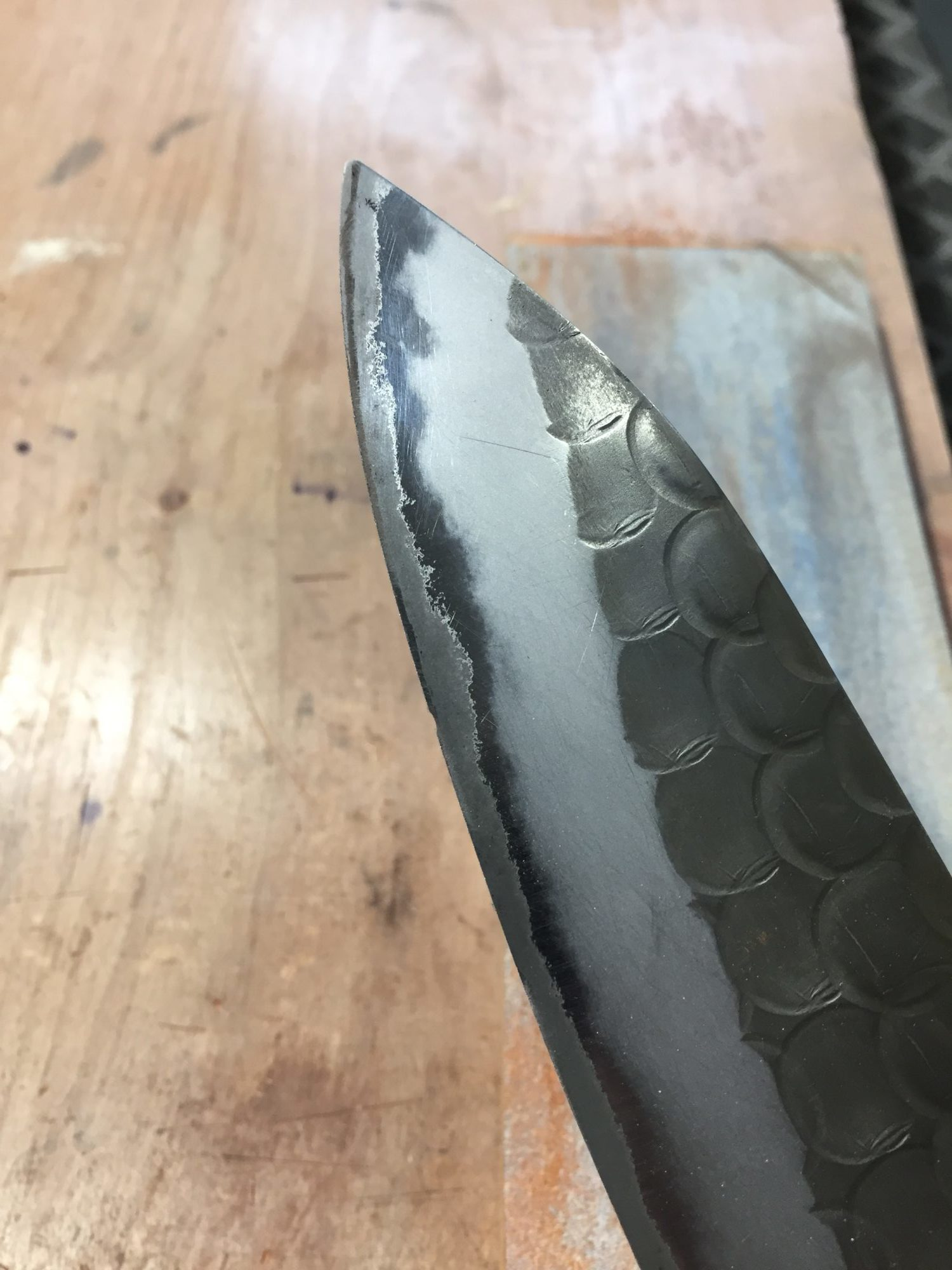 grinding out a chip in chef knife